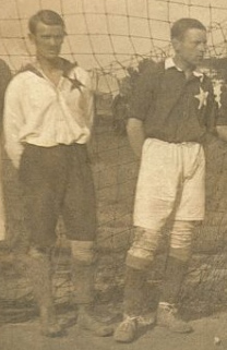 Wisła Kraków reactivation after World War I would not be complete without the restoration of the White Star. Note that the goalkeeper's shirt is the reversal of normal shirt: Michał Szubert (left) wears a white shirt with a red star.